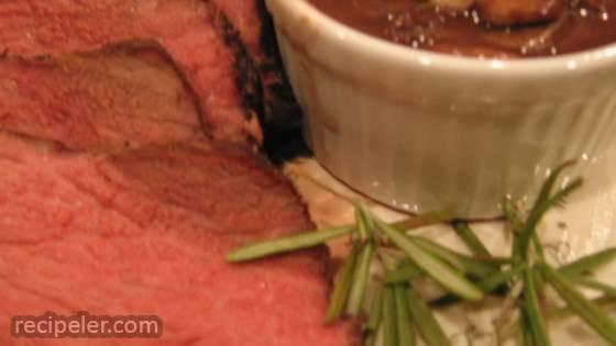 Boneless Garlic and Rosemary Rubbed Prime Rib with Red Wine Mushroom Sauce