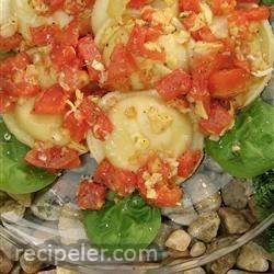 Cheese Ravioli with Fresh Tomato and Artichoke Sauce
