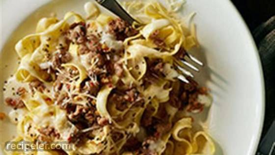 Fettuccine and Sweet talian Sausage with Light Alfredo Sauce