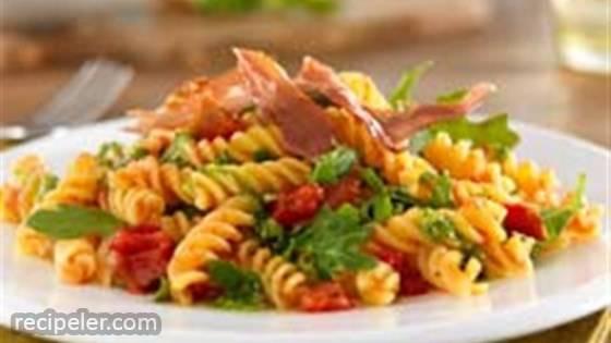 Gluten Free Rotini with Crispy Prosciutto, Pesto & Arugula