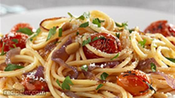 Gluten Free Spaghetti with Caramelized Red Onions, Cherry Tomatoes, Pine Nuts, and Pecorino Cheese