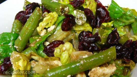 green bean salad with feta in a medium size bowl combine greens beans ...