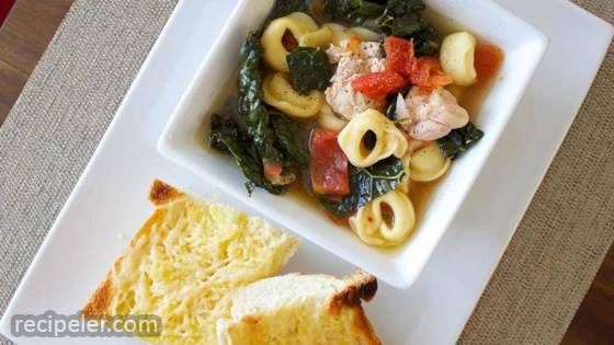 Hearty Chicken and Tortellini Stew with Cheesy Garlic Bread