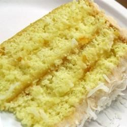 lemon cake with lemon filling and citrus/coconut frosting