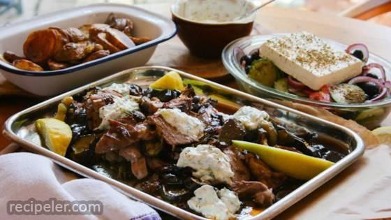 Roast Greek Lamb with Tzatziki, Roasted Vegetables, and Greek salad