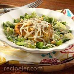 Roasted Chicken Thighs over Braised Escarole with Pine Nuts and Mozzarella