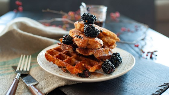 spicy gluten-free chicken and cheddar waffles with blackberry-maple syrup