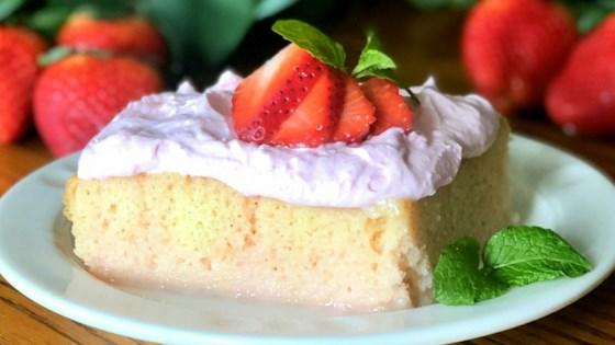 strawberries and cream baileys® poke cake