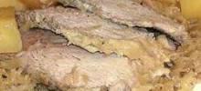 Slow Cooker German-Style Pork Roast with Sauerkraut and Potatoes