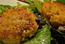 deviled crab cakes on mixed greens with ginger-citrus vinaigrette