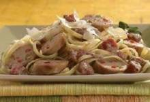 grilled sweet talian chicken sausage with tomato cream sauce over linguine