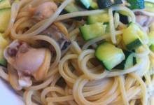 pasta with clams, zucchini, and zucchini blossoms