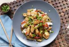 Szechuan Chicken, Peppers, and Peas on Rice